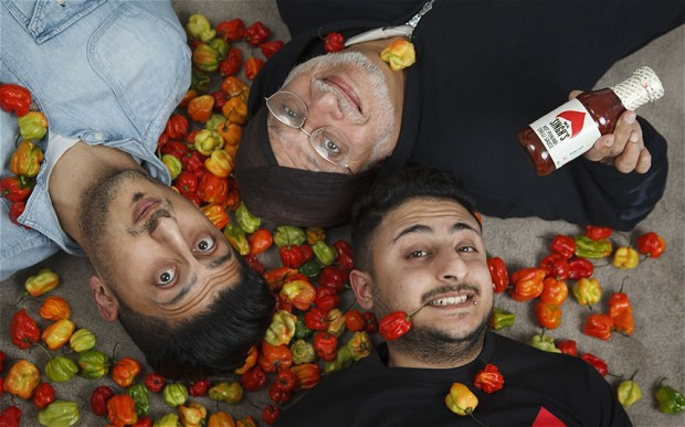 Laid back: Hardev Sahota with his sons Kuldip, 32 (left), and Sukhi, 23, and their popular Mr Singh's Sauce, which members of the family made by hand in their mother's kitchen until the orders got too big